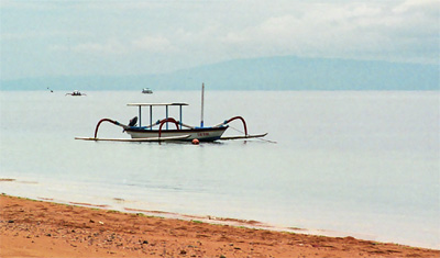 Typical Balinesean boat by the beach in sanur, bali