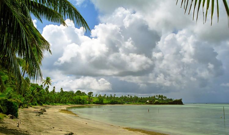 By palmtrees at Nacula Beach, Yasawa Islands, Fiji