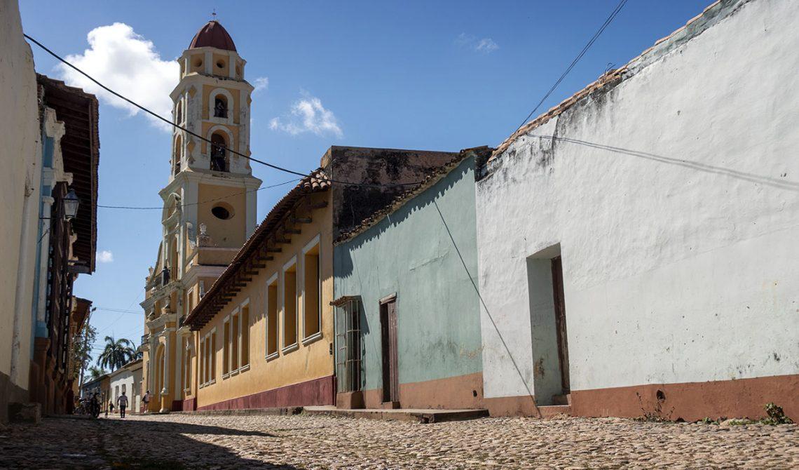 Cobblestone street and Trinidad church tower
